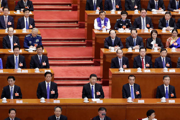 Chinese President Xi Jinping and other officials attend the seventh plenary session of the National People's Congress (NPC)