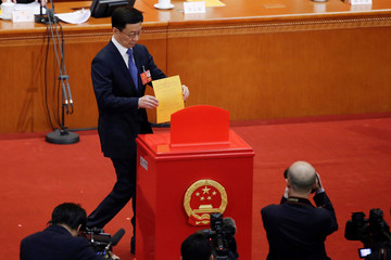 Chinese Politburo Standing Committee member Han Zheng casts his ballot at the seventh plenary session of the National People's Congress (NPC)