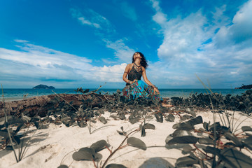 beautiful young boho woman on the beach