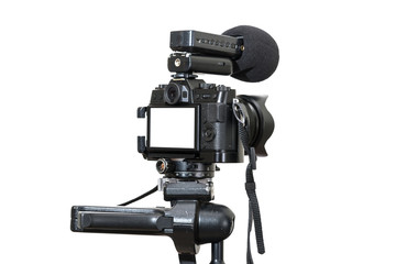 A Professional digital mirrorless camera on tripod with microphone for record on white background, Camera for photographer or Video, Live Streaming equipment concept