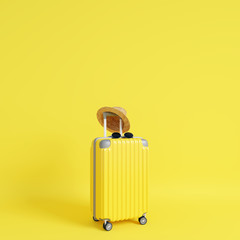 Wall Mural - Yellow suitcase with sun glasses and hat on yellow background. travel concept. minimal style