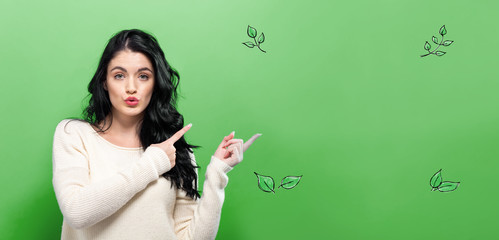 Green Leaves with young woman on a green background