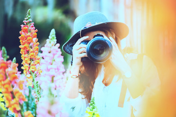 Photographer  asian women travel  nature. Travel relax.  Nature Study in flower Photography. At public park in summer. In Thailand
