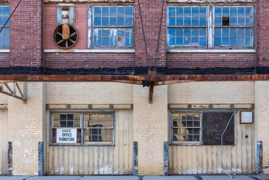 exterior of old abandoned brick warehouse in inner city