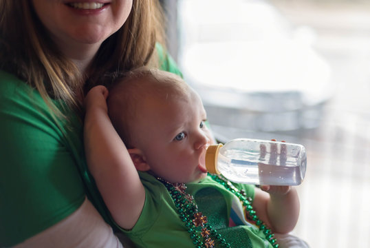 Young mom and baby girl dressed for St. Patrick's Day celebration