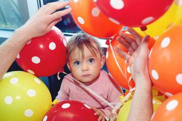 little girl with balloons . First birthday