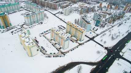 Winter city from a height. Photo taken by quadrocopter. Large tall buildings and road