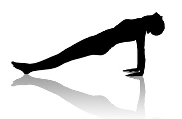 Black silhouette of flexible woman doing yoga.