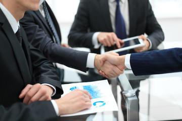 Business handshake. Close-up of business men shaking hands.