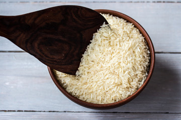 rice in the plate and wooden spoon