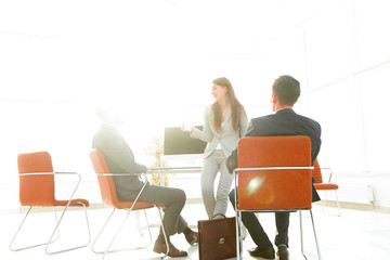 background image of a business team in the office.