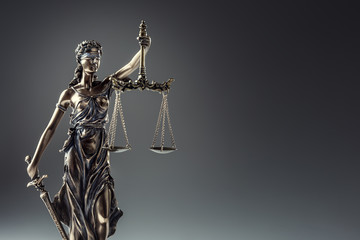 Statute of Justice. Bronze statue Lady Justice holding scales and sword Wall mural
