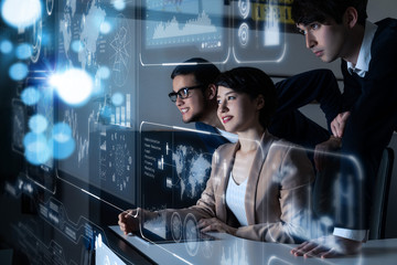 Group of people looking at the futuristic user interface.