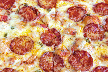 Pizza Pepperoni. Cheese and pieces of salami in close-up.