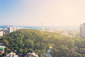 Thailand aerial high view point from Pattaya Unixx condo: park, ocean beach and condominiums. Relax background for meditations. Downtown with blue clear sky. Sunny day