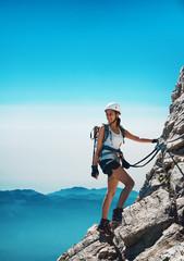 Foto op Aluminium Alpinisme Fit attractive woman mountaineer