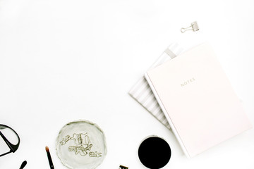 Female modern minimal blog composition with pink notebook on white background. Flat lay, top view.