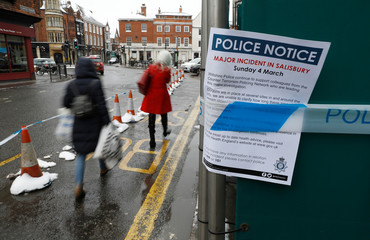 A police notice is attached to screening surrounding a restaurant which was visited by former Russian intelligence officer Sergei Skripal and his daughter Yulia before they were found on a park bench after being poisoned in Salisbury