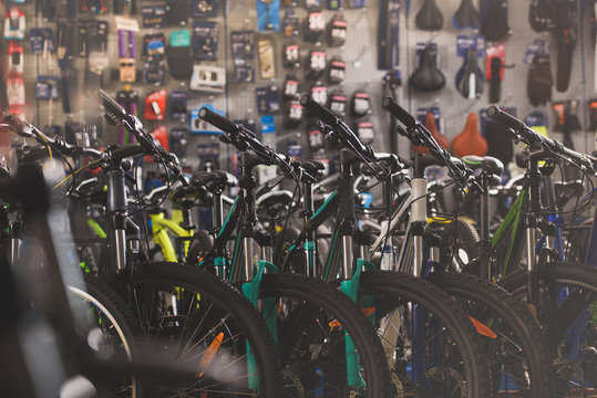 selective focus of various modern bicycles selling in bike shop