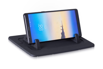 Plastic dark black color mobile stand with mobile phone and weather report show on the screen. Perfect mobile stand to keep your phone safe.