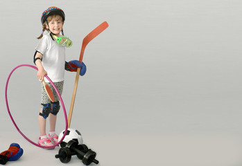 Child, kid, engaged in various sports. Sports equipment.