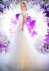 fashionable bride on a violet background