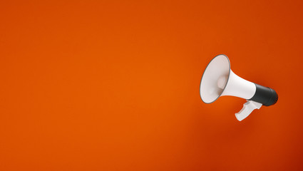 big megaphone in front of a red wall - 3D Rendering