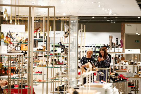 Designer shoes are displayed inside the new John Lewis store at the Westfield shopping centre in White City, London