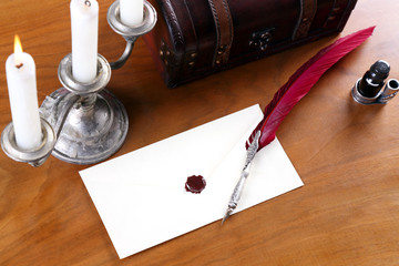 Letter written with a quill in the candle light