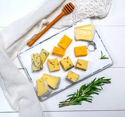 brie cheese, roquefort, camembert, cheddar and cheese with walnuts