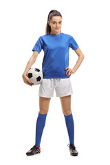 Female soccer player with a football