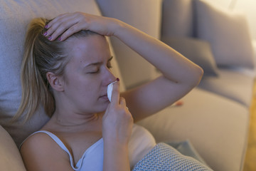 woman on sick leave with a handkerchief. symbolic photo for cold, cold and flu season