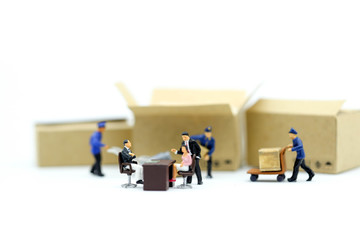 Miniature people : Business team with worker construction background.