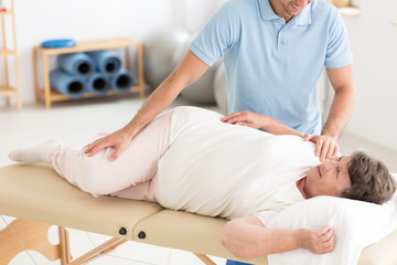 Chiropractor performing back adjustment