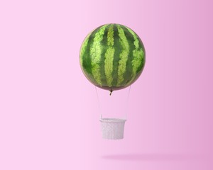 Big hot air balloon watermelon concept on pastel pink background with copy space for text. happy...
