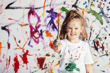 Cute child with smuges of colorful paint