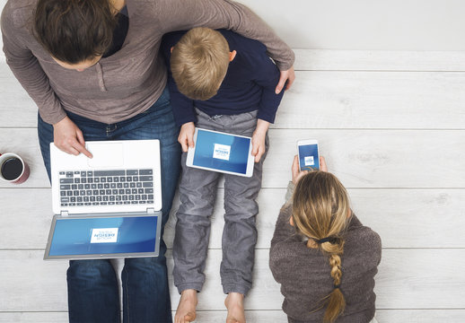 Family Sitting on Floor Using Devices Mockup 2