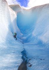 Woman climbing Mendenhall Glacier