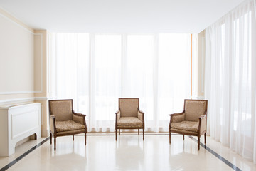 Three chairs in light room