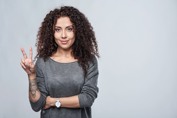 Hand counting - two fingers. Smiling woman showing two fingers, V sign