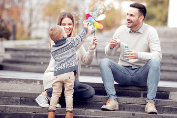 Happy beautiful family having fun in city