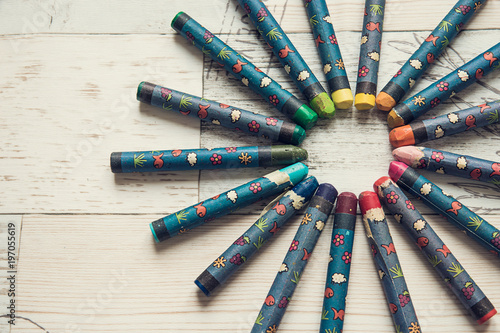 color wheel made of crayons on wooden background stock photo and