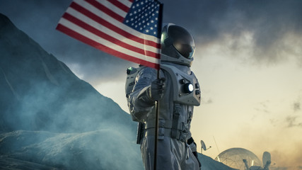 Astronaut Wearing Space Suit Plants American Flag on the Red Planet/ Mars. Patriotic and Proud Moment for the Whole of Humanity. Space Travel and Colonization Concept.