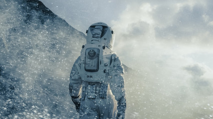Shot of the Astronaut Walking Through Blizzard on Alien Planet. Manned Mission To Europa, Technological Advance Brings Space Exploration, Colonization.