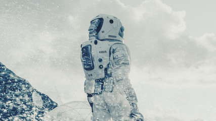 Shot of the Astronaut Looking Through the Snow Storm on Frozen Alien Planet. In the Background His Base/ Research Station. Technological Advance Brings Space Exploration, Colonization.