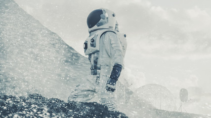Proud Astronaut Confidently Explores Alien Planet's Surface During Snow Storm. People Overcoming Difficulties, Important Moment for the Human Race.