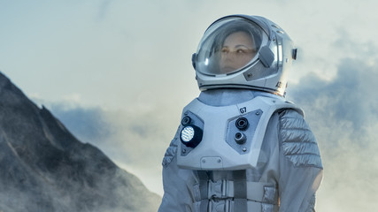 Shot of Female Astronaut in the Space Suit Looking Around Frozen Alien Planet. Advanced Technologies, Space Travel, Colonization Concept.