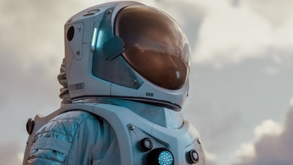 Shot of the Brave Astronaut in the Space Suit Looking Around Alien Planet. Blue and Cold Planet. Advanced Technologies, Space Travel, Colonization Concept.