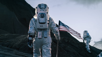 Shot of the Two Astronauts Exploring Mars/ Red Planet. One Cosmonaut Carries American Flag. Technological Advance Brings Space Exploration, Travel, Colonization Concept.