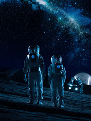 Two Astronauts in Space Suits Stand on the Alien Planets Looking at the Stars in Milky Way Galaxy. Space Travel and Extraterrestrial Colonization Concept.